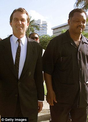 'Creepy': RFK Jr was in jail with Rev. Al Sharpton (left) and the wife of Rev. Jesse Jackson (right), and he wrote disparagingly about the two black civil rights leaders