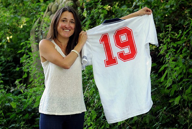 Could be yours: Board member Liz Luff shows off Gazza's shirt from a Italia '90 warm-up game