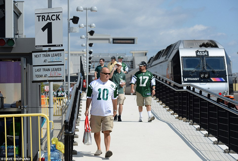 Touching down: New York Jets fans arrive on trains from Manhattan in anticipation of their season opener