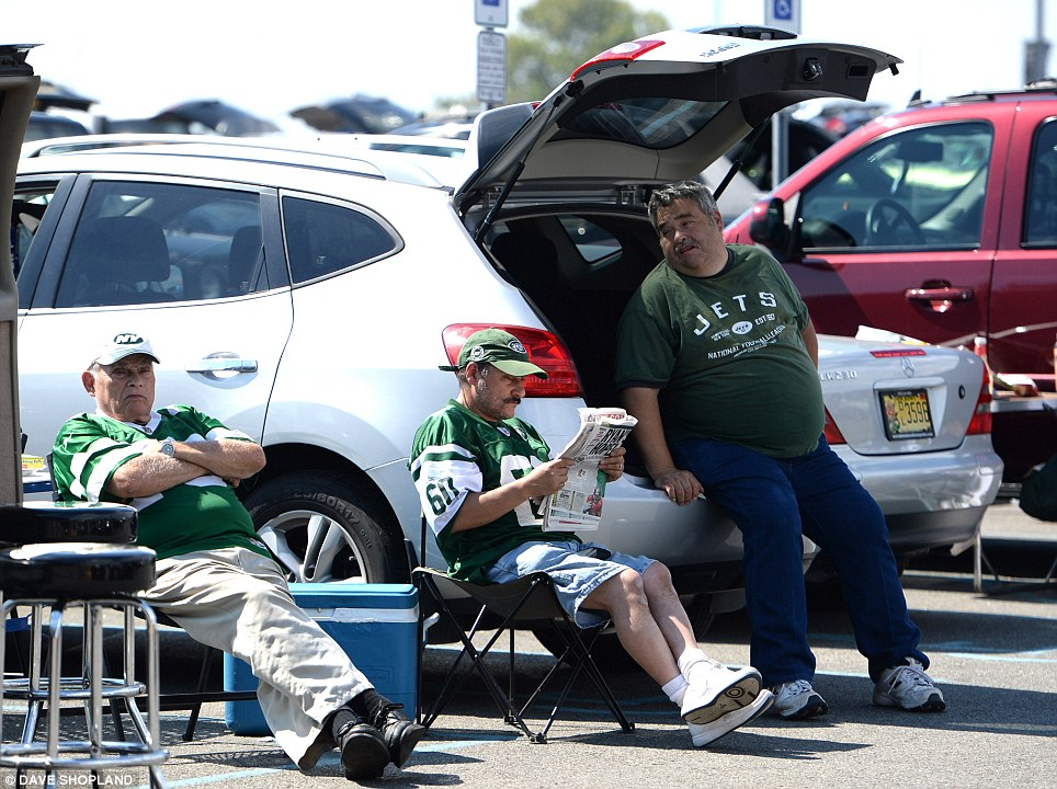 Tradition: Spectators 'tailgate' in the car park before the game. Tailgating is common all over America and not just for NFL matches