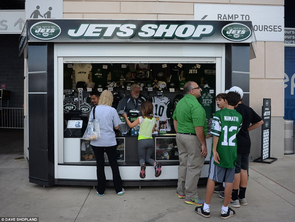 Gift: A souvenir and memorabilia shop outside the stadium opens for business before the game