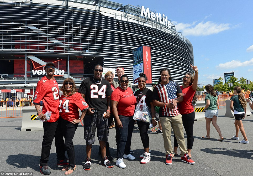 Gameday: American football spectators stop for a picture outside MetLife Stadium before the match