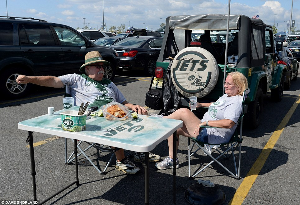 Party spirit: Tailgating usually involves grilling food and drinking alcohol while engaging with other supporters