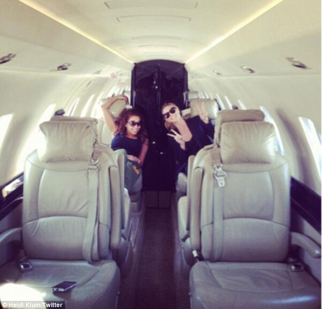 Was this an upgrade? Heidi Klum hangs out in the largely empty cabin of a private jet on her way to New York City