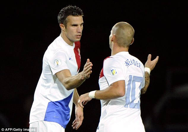 On target: Robin Van Persie (left) celebrates with Holland teammate Wesley Sneijder after his brace