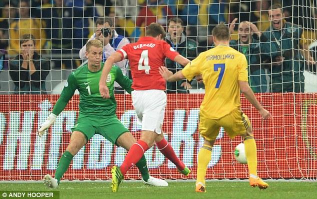 Vital interception: Gerrard robs the ball off Andriy Yarmolenko's toe