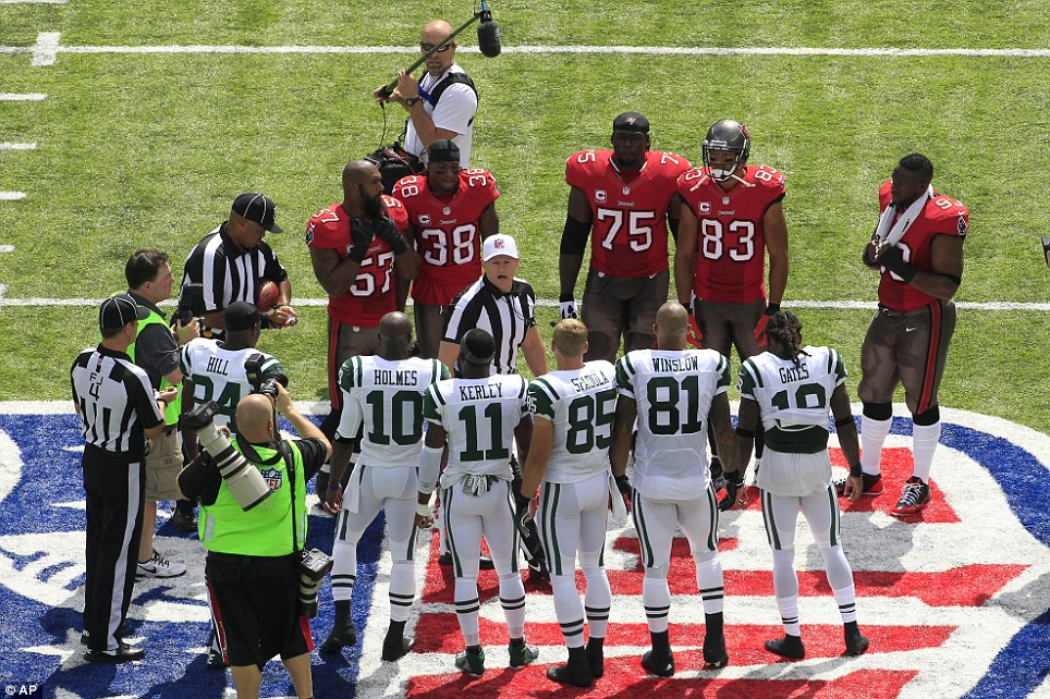 Decision: The players gather in the middle of the field for the coin toss before the game