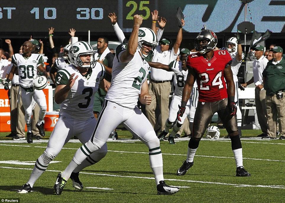 Delight: New York kicker Nick Folk (centre) celebrates kicking the game winning field goal as the Jets won 18-17 in their season opener