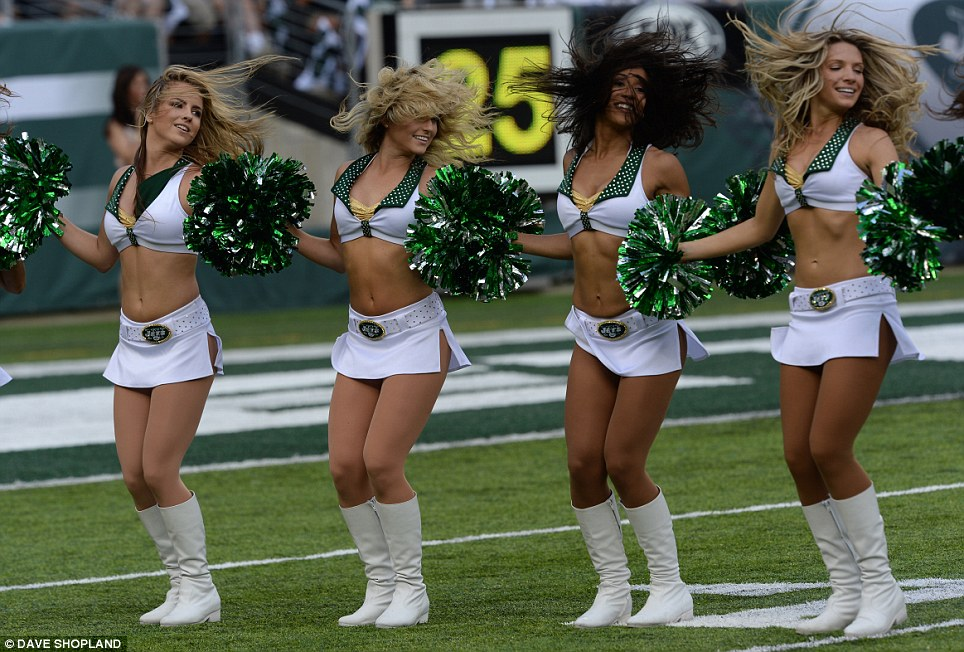 Routine: The Jets cheerleaders perform for the crowd during a break in play in the season opener