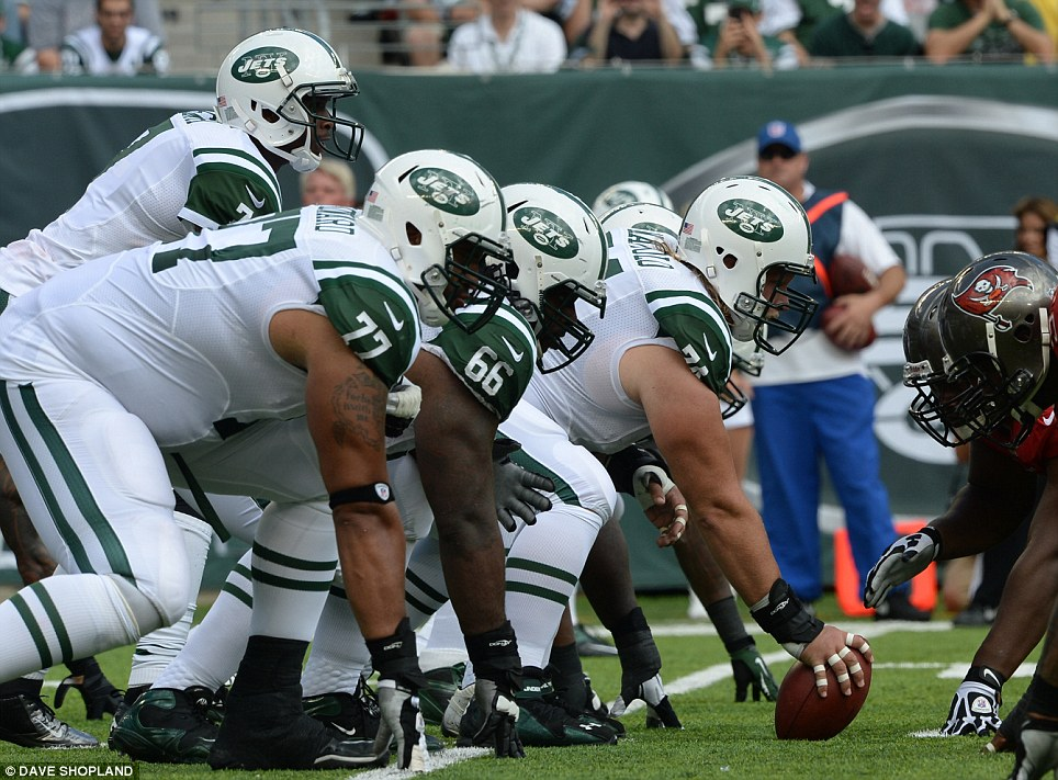 Ready for action: The Jets offence prepares to run a play from the line of scrimmage
