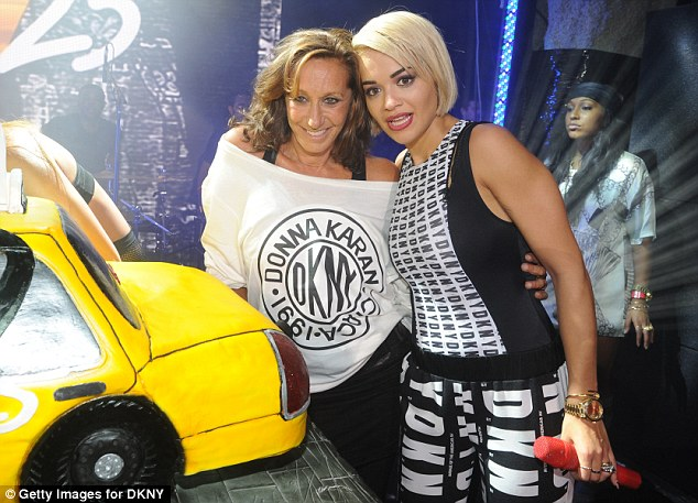 Cause for celebration: Donna Karen and Rita Ora pose by the birthday cake at the event