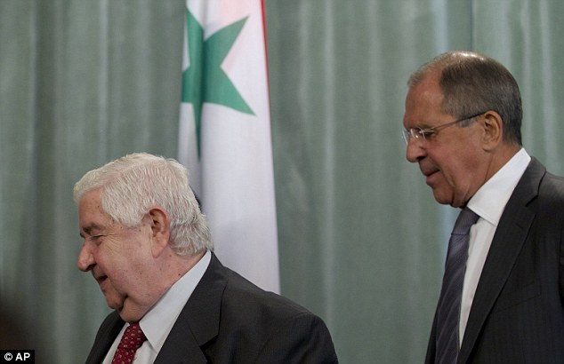 Russian Foreign Minister Sergey Lavrov, left, and his Syrian counterpart Walid al-Mouallem . They say they will push for the United Nations to continue their probe into the use of chemical weapons