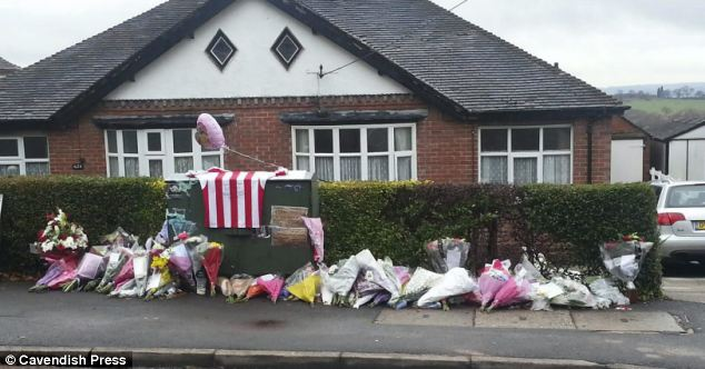 Devastation: Friends and family left tributes to the men at the scene where the Renault crashed into a residential garden in Stoke-on-Trent