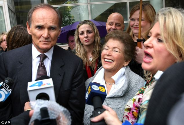 Cleared: Goodman grins with her attorneys Robert Sheahen and Alison Triessl after being cleared in November