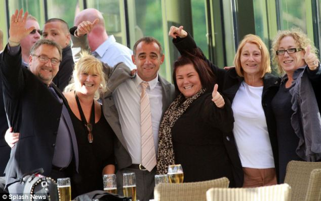Oh brother, we love you: Actor Michael Le Vell celebrates his acquittal yesterday surrounded by his jubilant family members