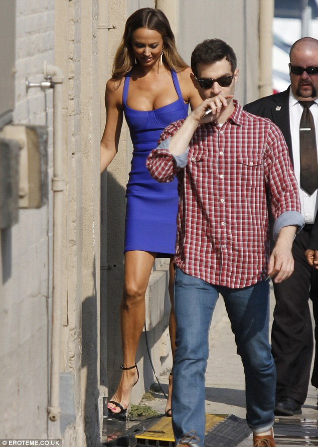 Watch your step: Stacy Keibler struggles to walk over bumps in the pavement in her strappy stilettos as she arrives for Jimmy Kimmel Live!
