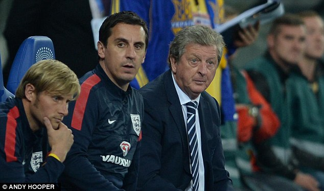 Stony-faced: England boss Roy Hodgson watches his side draw 0-0 in Ukraine next to assistant Gary Neville