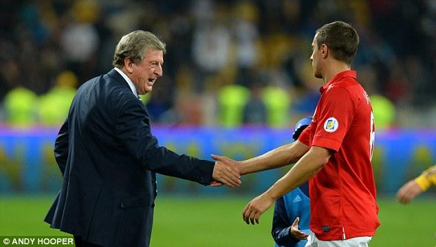 Good game: England boss Hodgson congratulates Phil Jagielka after 90 minutes