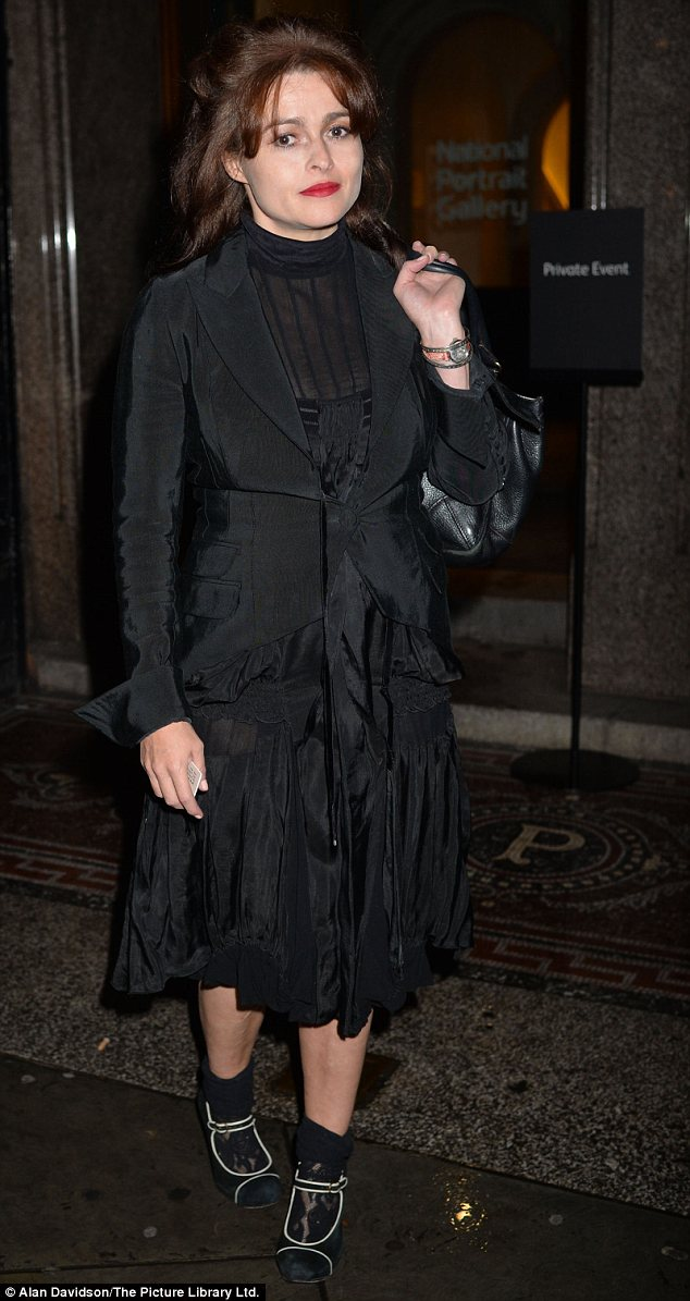 Gothic: Helena Bonham Carter looked darkly beautiful in a black two-toned jacket over a sheer ruffled dress and lace socks