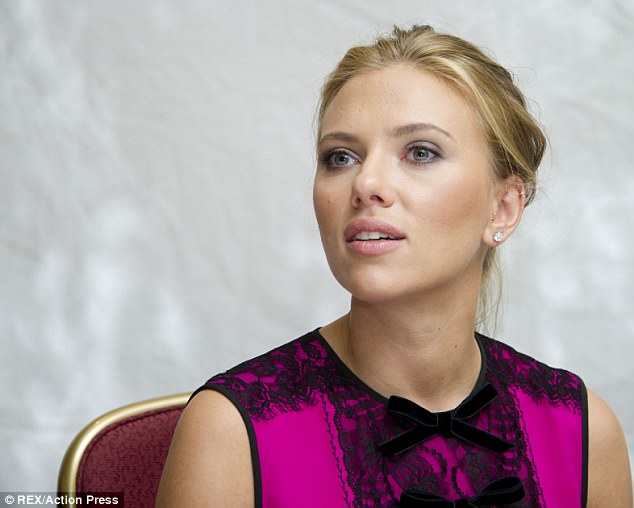 All tied up: Scarlett looked pretty in pink with her velvet and lace detail top