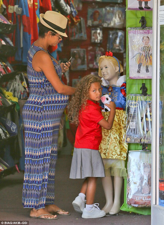 Definite favourite: A mannequin was dressed up in the costume and, as the little girl and her mother walked into the store, Nahla gave it a big hug