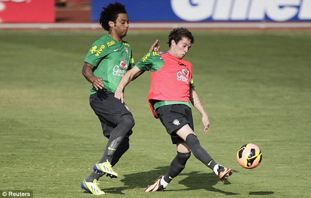Doubt: Marcelo (left) is also injured, meaning Bale could make his Real Madrid debut at left back