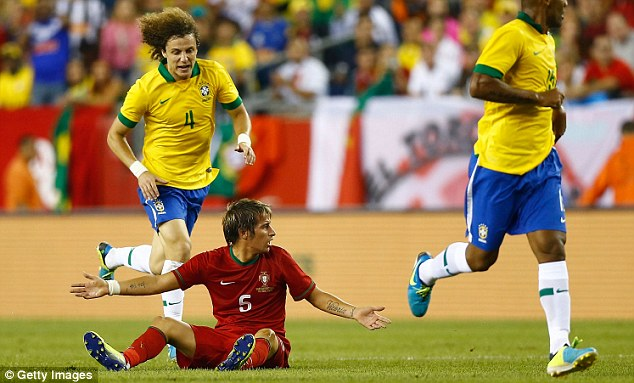 Blow: Fabio Coentrao limped out of Portugal's friendly defeat to Brazil