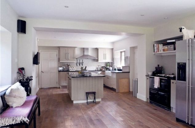 Spacious: The open plan kitchen and breakfast room with large central island is described as 'magnificent' by agents