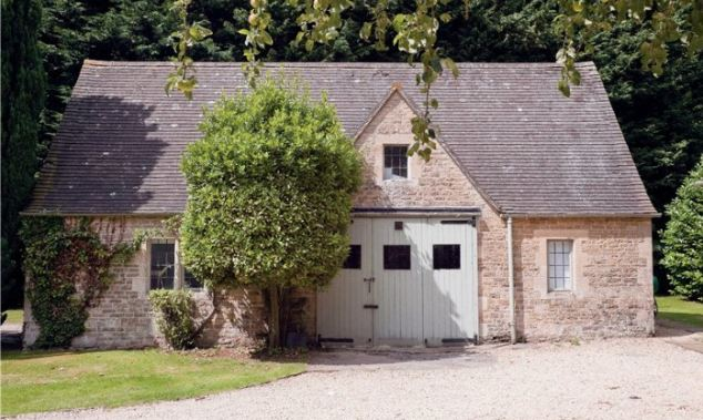 Cosy: Nestled into 12 acres of grounds the property also has a separate two bedroom cottage with spiral staricase