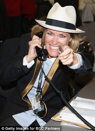 Singer Cerys Matthews speaks on the phone on the trading floor during the BGC event