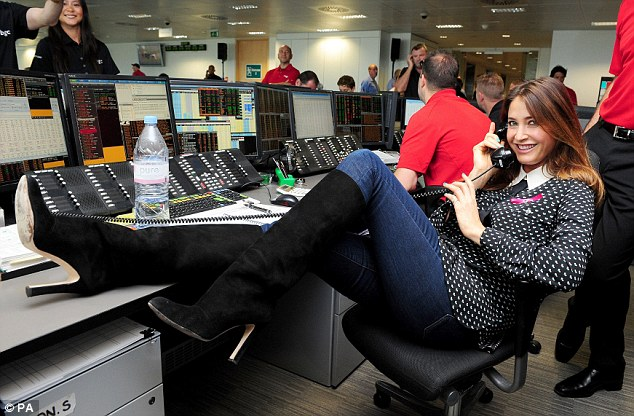 Making herself at home: Lisa Snowdon appeared very relaxed on the trading floor