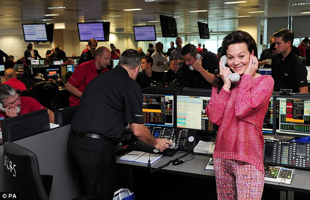 Brightening up the office: Helen McCrory wore a pink jumper with matching trousers for her day on the trading floor
