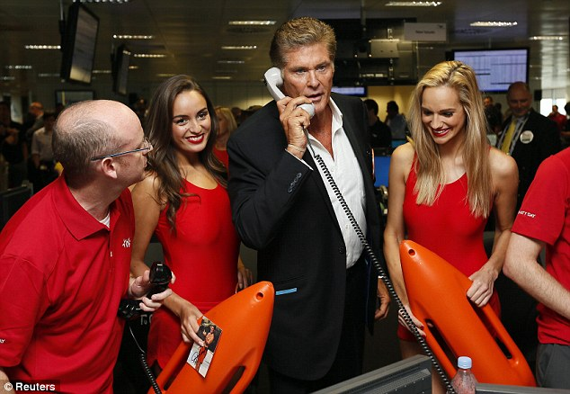 The Hoff gets down to business: David Hasselhoff with two 'Baywatch beauties' on the trading floor