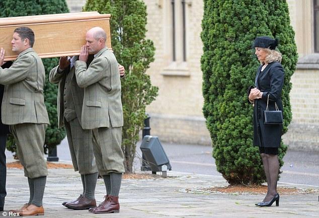Devastated: Mr Van Cutsem's wife Emilie follows her husband into the church