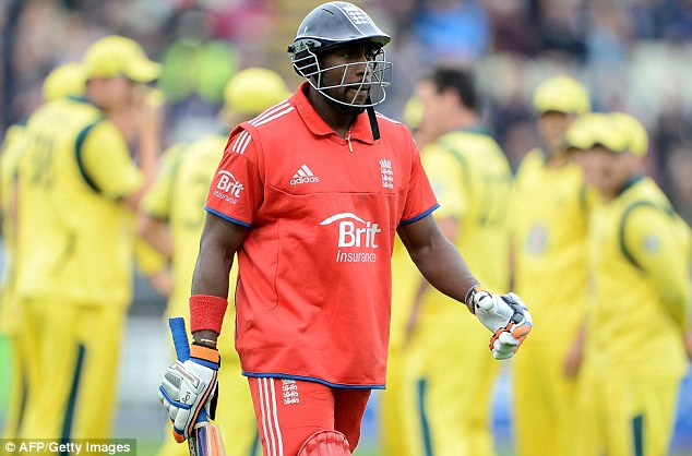 The long walk: Michael Carberry trudges off after being run out after a mix-up with Kevin Pietersen