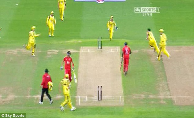 Gone: Carberry knows the game is up as Mckay races to the stumps and (below) takes off the bails