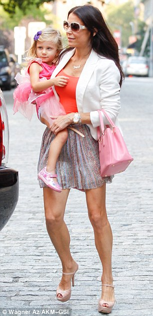 Mother duties: Bethenny was spotted Wednesday in New York picking up her daughter from school in a white blazer, orange vest, and frilly patterned skirt