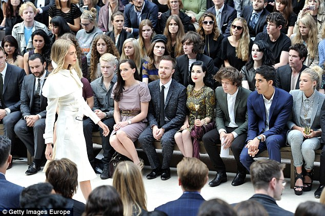 Front row: Harry was seen watching Cara on the catwalk for Burberry last year