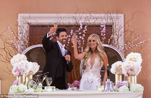 Cheers! The five-foot-four stunner wore three dresses by Mark Zunino to wed the 41-year-old CEO, who works at his adoptive father's law firm in Irvine