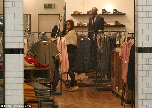 Treating herself: Chantelle was seen picking up some clothes during her shopping trip