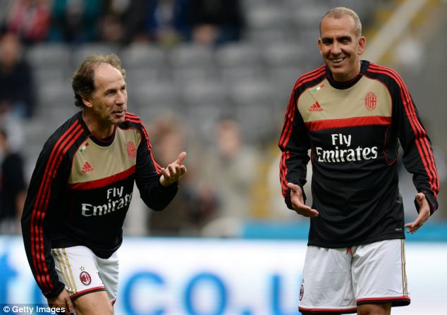 All smiles: Sunderland boss Paolo Di Canio laughs with Franco Baresi after getting booed by the home fans