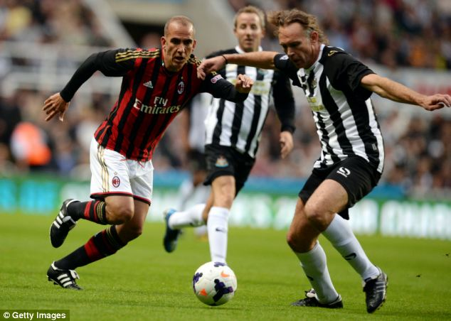 Still got it: Di Canio chases down former Toon defender Darren Peacock
