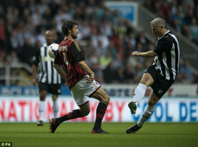 Battle: Rob Lee goes up against Dutch legend Mark van Bommel in midfield