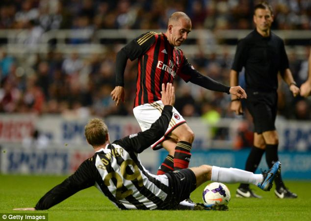 Target: Di Canio is on the receiving end of a challenge from Lee Bowyer