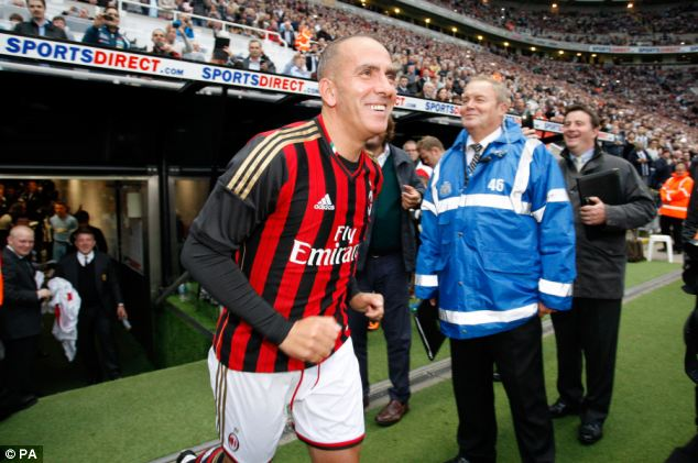 Boo boys: Di Canio smiles as the St James' Park crowd welcome him onto the pitch