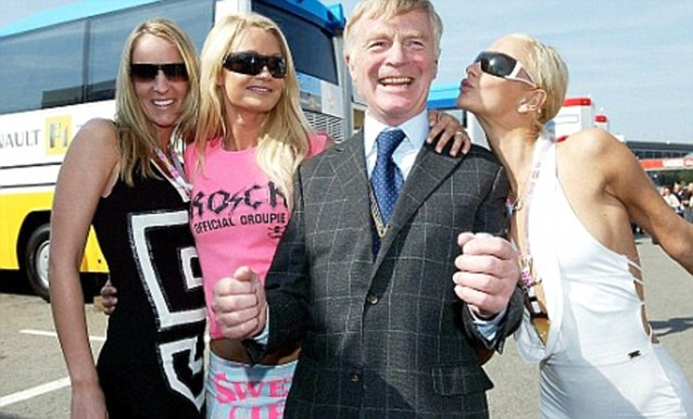 Mr Mosley, pictured here with F1 models in Barcelona, faced calls for his resignation when the story was published