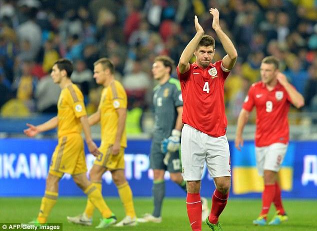 Hard earned point: Sreven Gerrard applauds England's traveling fans after the draw
