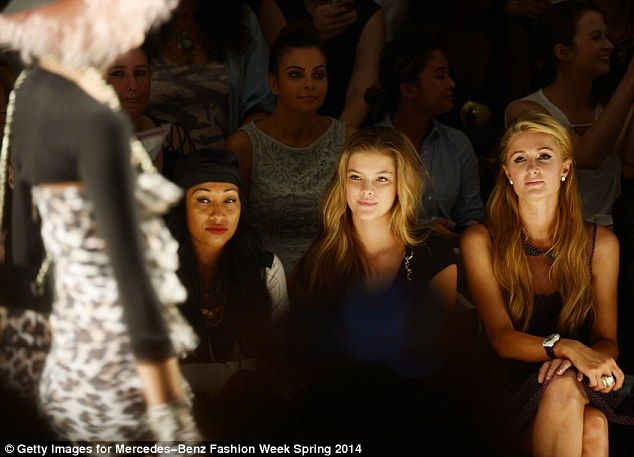 Nina and Paris take in the show