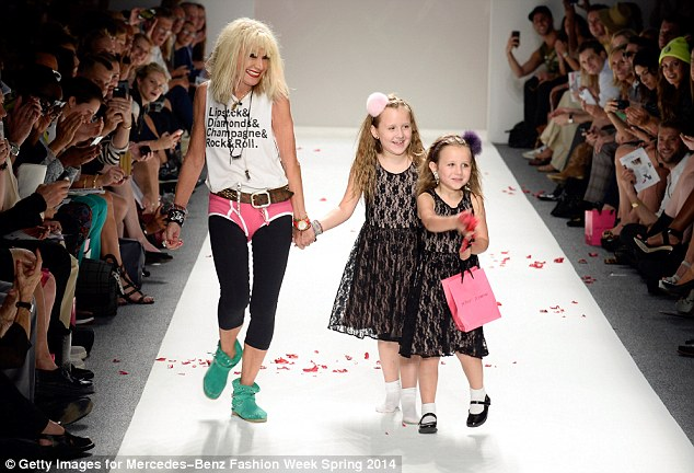 Betsey Johnson takes the obligatory walk along the runway with granddaughters Ell and Layla