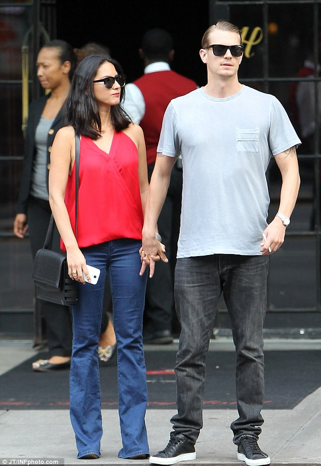 Olivia Munn and Joel Kinnaman wait for a cab outside their hotel in New York City on Wednesday